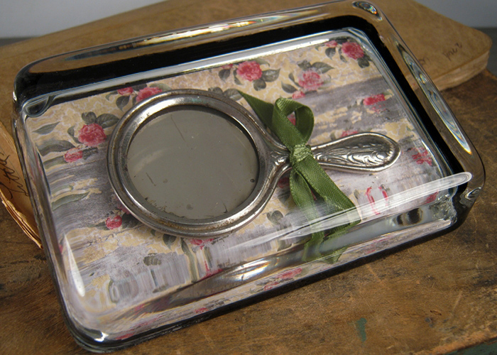 This Child's Antique Mirror Makes an Adorable Papeweight... Perfect for Quick Makeup Checks in the Office